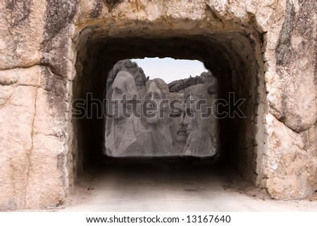 Looking at Mount Rushmore through a tunnel . - stock photo