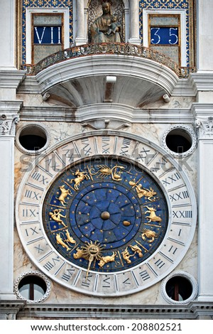 Looking at the historical clock on the Torre del' Orologio on the St. Mark's square in Venice.