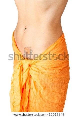 Looking at the naked abdomen of a girl with tattoo - stock photo