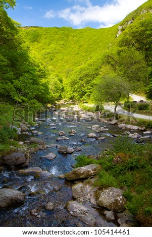 Looking back down the River Lyn between Watersmeet and Lynmouth in Devon.  This is a beautiful 1 3/4 mile walk along the River Lyn and one of the best in Devon - stock photo