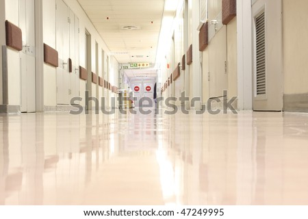 Looking down a hospital hall way - stock photo