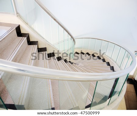 Looking down at a spiral stair in a house. - stock photo