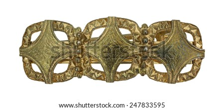 Looking down at a sturdy gold barrette from the mid 1950s.