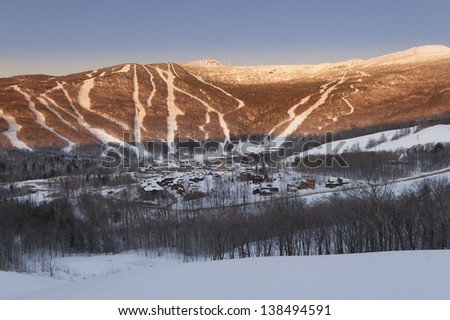 Looking down at the ski lodge and hotel with Mt. Mansfield looming behind, Stowe, Vermont, USA - stock photo
