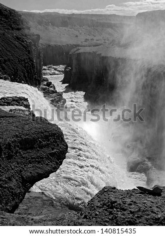 Looking down from the Gullfoss falls (black and white) - stock photo