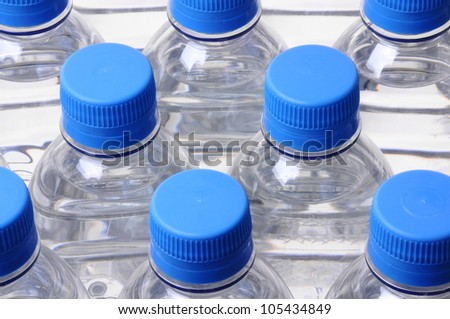 looking down on a group of water bottle lids - stock photo