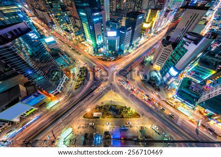 Looking down on a major interstection at night in Seoul, South Korea. - stock photo
