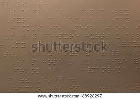 Looking down on a page from a Braille textbook showing a large amount of the page - stock photo