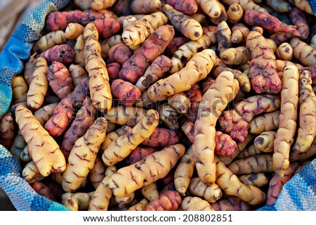 Looking down on a sacks of potatoes in a Peru marketplace in the Urubamba Valley. - stock photo