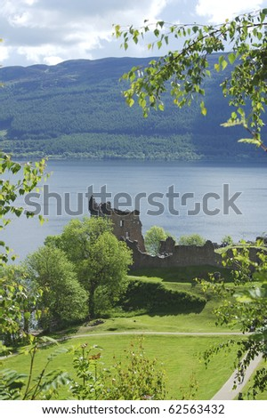 looking down on Castle Urquhart on side of loch Ness in scottish Highlands - stock photo