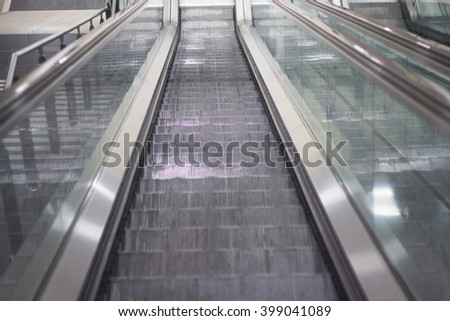 looking down on escalator in metro station