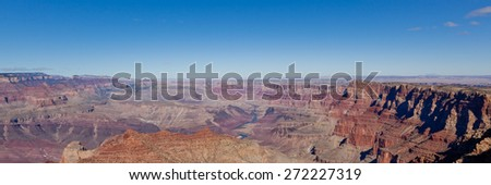 Looking down on the colorful and amazing landscape of the Grand Canyon National Park with the Colorado River running through it in Arizona. - stock photo