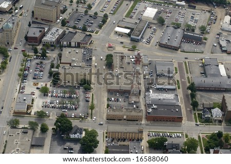 Looking down on the commercial district of a small city. - stock photo