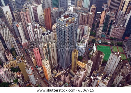 Looking down on Wan Chai Hong Kong as seen from the top of a tall building. a built out tightly congested futuristic cityscape if ever there was.