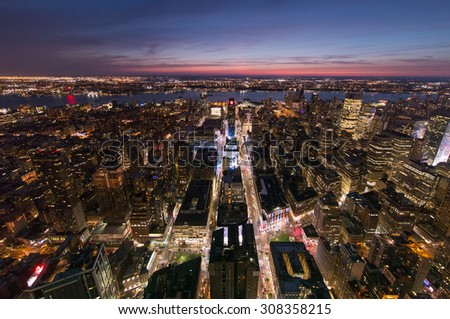 Looking down 33rd and 34th Streets with Broadway, to the Hudson River & New Jersey, in Midtown New York. - stock photo