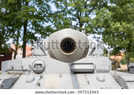 Looking down the barrel of a grey german wwii tank - stock photo
