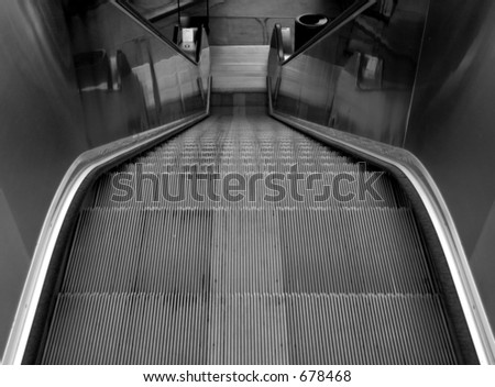 Looking Down The Escalator