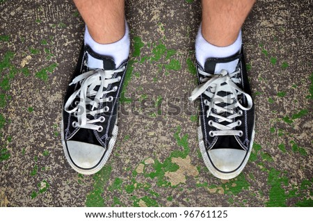 Looking down wearing casual shoes - stock photo