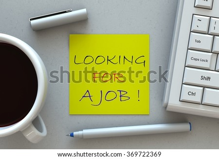 Looking for a job!, message on note paper, computer and coffee on table - stock photo
