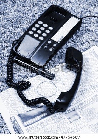 Looking for a job on a newspaper - stock photo