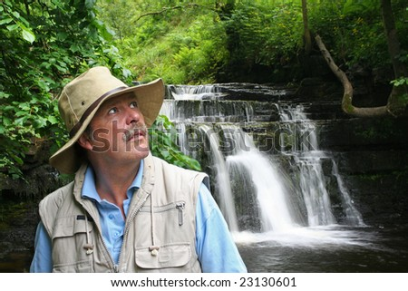 looking for a way out of Ravine deep in the Forest - stock photo