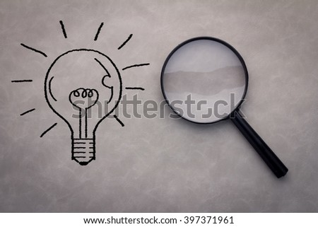 Looking For An Idea   with magnifying glass busniess concept.jpg - stock photo
