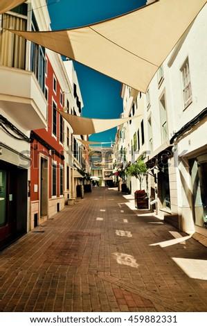 Looking for shadow. Mahon street, Minorca, Spain - stock photo