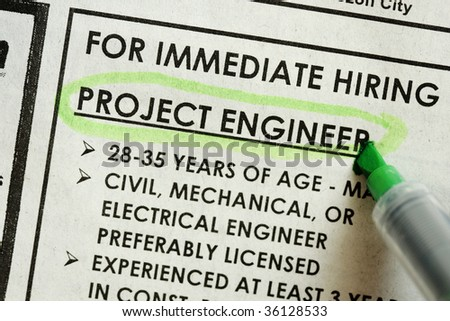 looking for something in newspaper, project engineer immediate hiring - stock photo