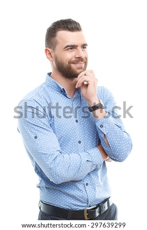 Looking forward. Handsome smiling businessman standing on white isolated background and touching his chin with hand