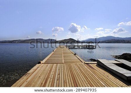 Looking forward to the sea and clouds on a gangplank - stock photo
