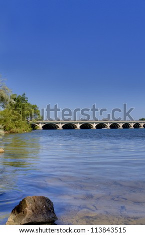 Looking from Belle Isle in Detroit Michigan towards the Belle Isle Bridge on a summer day. - stock photo