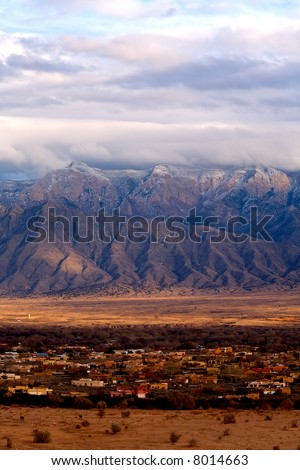 Looking from Rio Rancho over Corralles at the Sandia's. - stock photo