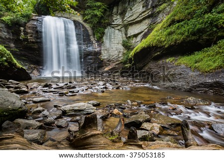 Looking Glass Falls in spring - stock photo