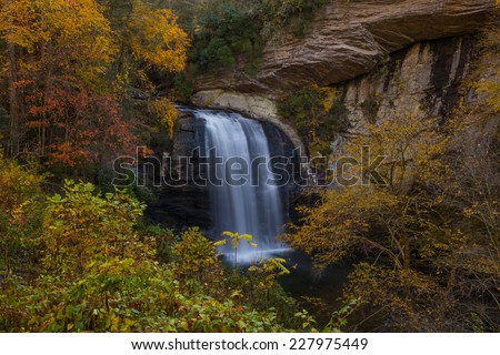 Looking Glass Falls With Colorful Fall Foliage - stock photo