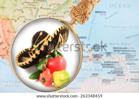 Looking in on a Mexican Cuisine with a blurred map of the Caribbean in the background - stock photo