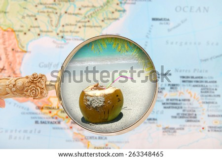 Looking in on a tropical beach with a blurred map of the Caribbean in the background - stock photo