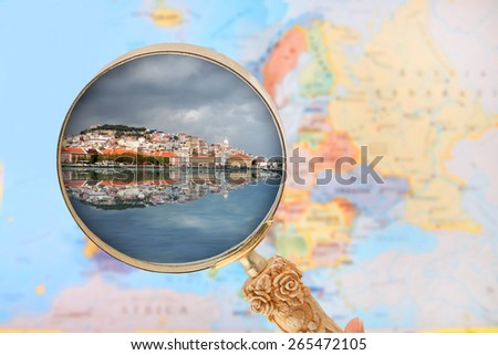Looking in on Lisbon, Portugal with blurred map of Europe in the background - stock photo