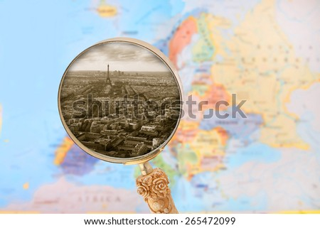 Looking in on the cityscape of Paris, Francis showing the Eiffel Tower with blurred map of Europe in the background - stock photo
