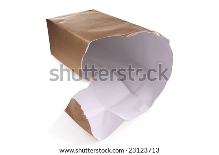Looking into an unwrapped and opened gift.  The gift box has been removed leaving only the gold wrapping paper torn open on one end. - stock photo