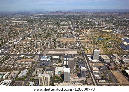 Looking North up Central Avenue from Indian School Road in Phoenix, Arizona from a helicopter - stock photo