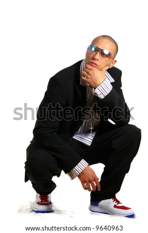Looking On Young man in stylish business fashion with sunglasses on - over white background. - stock photo