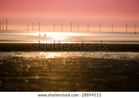 Looking onto Seaforth wind farm from Crosby Beach with dramatic sunset