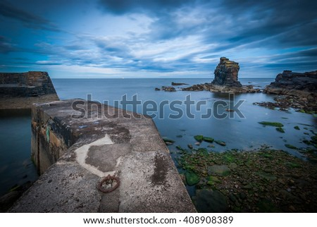 Looking out across a calm sea evening the evening at Latheronwheel Harbour in Scotland, UK. - stock photo