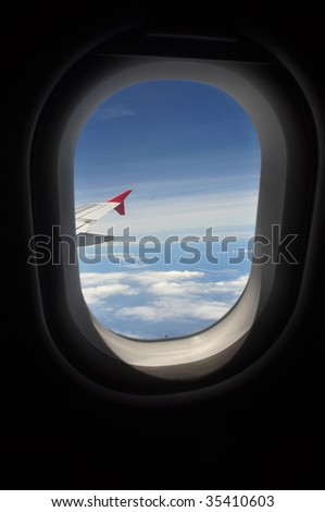 Looking Out Airplane Window - stock photo