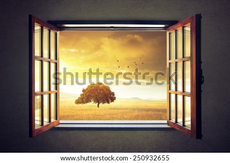 Looking out an open window to a sunny spring countryside landscape - stock photo
