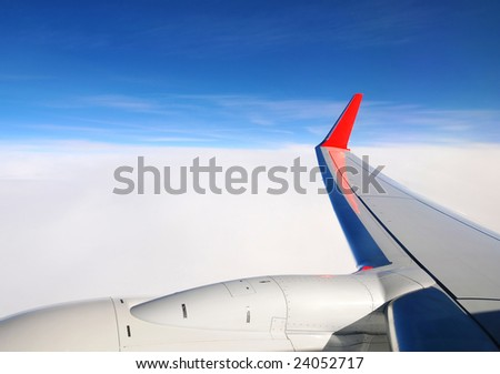 Looking out of Airplane window during flight - stock photo