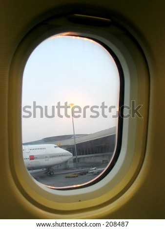 looking out the airplane window - stock photo
