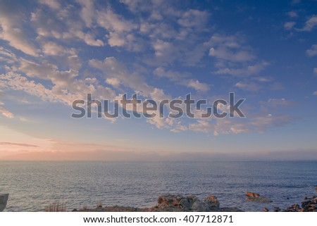 Looking out to sea from the Isle of Portland at Sunrise. Uk - stock photo