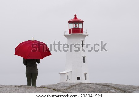 Looking out to sea in the rain (Peggy's Cove, Nova Scotia, Canada) - stock photo