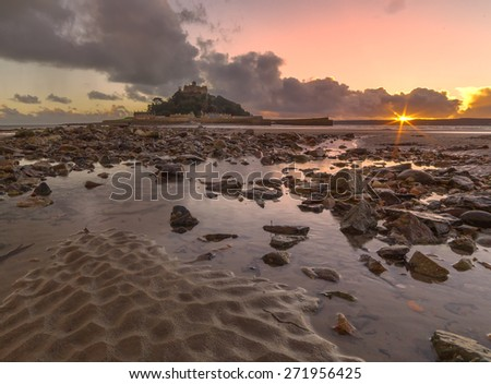 Looking over textured sand towards St. Michaels Mount, Cornwall, England, UK - stock photo